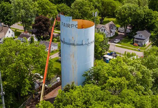 water tower being demolished