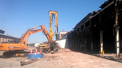 crane demolishing building